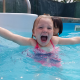 child in pool swimming